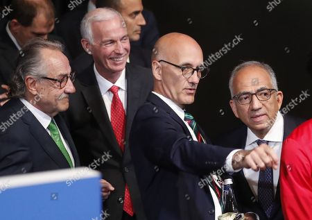 Decio de Maria (L), co-chairman of the Canada?Mexico?United States 2026 FIFA World Cup bid and president of the Mexican Football Federation, Steven Reed (red tie),  co-chairman of the Canada?Mexico?United States 2026 FIFA World Cup bid and president of the Canadian Soccer Association, John Kristick (pointing), executive director of the Canada?Mexico?United States 2026 FIFA World Cup bid and Carlos Cordeiro, co-chairman of the Canada?Mexico?United States 2026 FIFA World Cup bid and president of the United States Soccer Federation take part in the 68th FIFA Congress in Moscow, Russia, 13 June 2018.