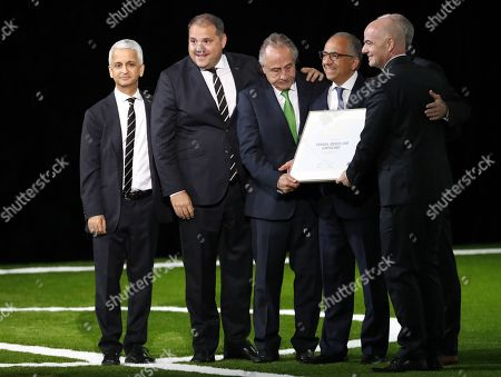 (from left) FIFA Council member Sunil Gulati, CONCACAF president Victor Montagliani, Decio de Maria, president of the Mexican Football Federation, Carlos Cordeiro, president of the United States Soccer Federation, Steven Reed, president of the Canadian Soccer Association and FIFA president Gianni Infantino after the joint bid won the vote for FIFA World Cup 2026 at the 68th FIFA Congress in Moscow, Russia, 13 June 2018.