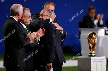 (from left) Steven Reed, president of the Canadian Soccer Association, Decio de Maria, president of the Mexican Football Federation, Carlos Cordeiro (facing left), president of the United States Soccer Federation and CONCACAF president Victor Montagliani celebrate after the joint bid won the vote for FIFA World Cup 2026 at the 68th FIFA Congress in Moscow, Russia, 13 June 2018.