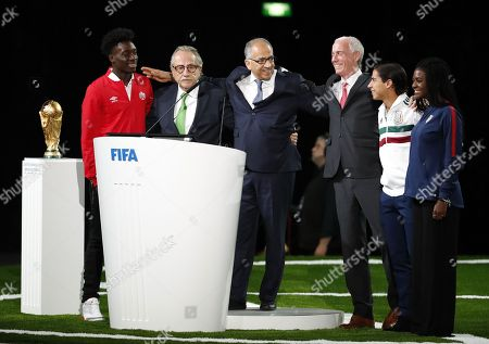 Stock Photo of (frm left) Canadian international player Alphonso Davis, Decio de Maria, president of the Mexican Football Federation,  Carlos Cordeiro, president of the United States Soccer Federation, Steven Reed, president of the Canadian Soccer Association, Diego Lainez, member of the Mexico men's Under-21 team and Brianna Pinto, member of the US Under-20 women team pose after their presentation of the Canada?Mexico?United States 2026 FIFA World Cup bid at the 68th FIFA Congress in Moscow, Russia, 13 June 2018.