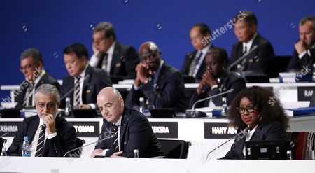 FIFA president Gianni Infantino (C), Salman Bin Ibrahim Al-Khalifa, President of the Asian Football Confederation and FIFA general secretary Fatma Samba Diouf Samoura (R) at the start of the 68th FIFA Congress in Moscow, Russia, 13 June 2018.