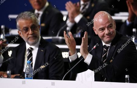 FIFA president Gianni Infantino (R) and Salman Bin Ibrahim Al-Khalifa, President of the Asian Football Confederation, at the start of the 68th FIFA Congress in Moscow, Russia, 13 June 2018.