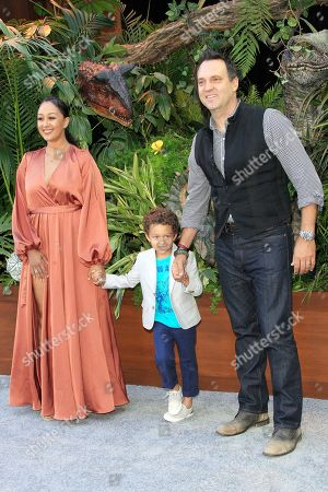 (L-R) US actress Tamara Mowry Housley, her son Aiden, and husband Adam Housley pose for photographers during the premiere of 'Jurassic World: Fallen Kingdom' at the Walt Disney Concert Hall in Los Angeles, California, USA, 12 June 2018. The film opens in the US on 22 June 2018.