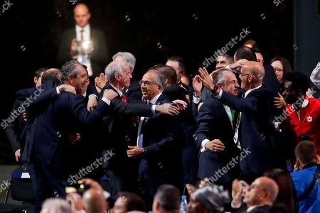 Steve Reed, Carlos Cordeiro. Carlos Cordeiro, U.S. soccer president Delegates of Canada, center, hugs Steve Reed, president of the Canadian Soccer Association, second left, after the United bid from Canada, Mexico and the United States won the vote to host the 2026 World Cup during the FIFA congress in Moscow, Russia