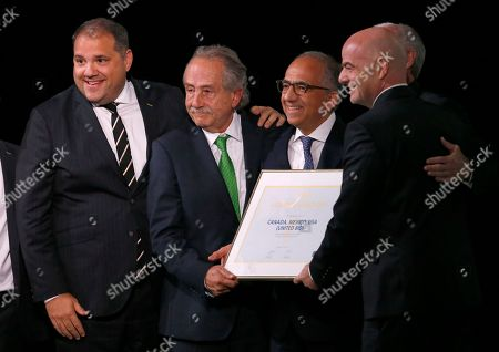 Stock Photo of Delegates of Canada, Mexico and the United States celebrate with FIFA President Gianni Infantino, right, after winning a joint bid to host the 2026 World Cup at the FIFA congress in Moscow, Russia, . From left: Victor Montagliani the president of CONCACAF, Decio de Maria, President of the Football Association of Mexico, Carlos Cordeiro, U.S. soccer president and Steve Reed, president of the Canadian Soccer Association (covered by Infantino