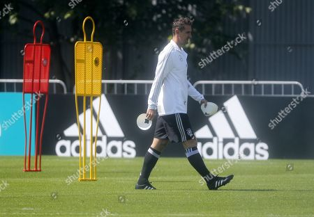 Former player and now member of the German national team coaching staff Miroslav Klose gets ready for a training session of the German national team in Moscow, Russia, 13 June 2018.