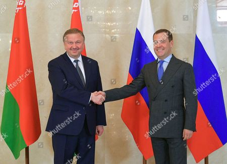 Stock Image of Russian Prime Minister Dmitry Medvedev (R) shakes hands with Belarus Prime Minister Andrei Kobyakov (L) before a meeting of the Union State Council of Ministers in Moscow, Russia, 13 June 2018.