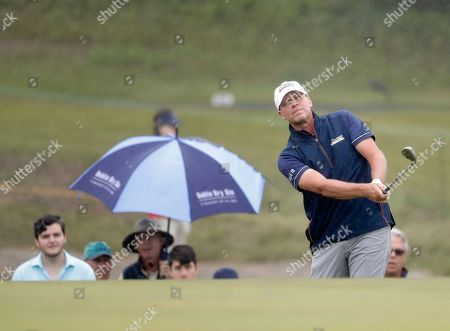 Steve Stricker chips onto a green during a practice round for the U.S. Open Golf Championship, in Southampton, N.Y