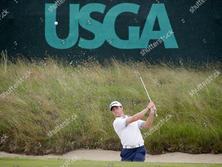 Cole Miller hits out of a bunker during a practice round for the U.S. Open Golf Championship, in Southampton, N.Y