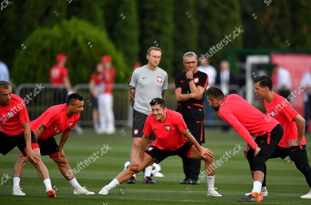 Stock Picture of Polish national soccer team players (L-R) Kamil Grosicki, Slawomir Peszko, Robert Lewandowski with goalkeepers Bartosz Bialkowski and Wojciech Szczesny attend a training session in Sochi, Russia, 13 June 2018. The Polish team prepares for the FIFA World Cup 2018 taking place in Russia from 14 June until 15 July 2018.