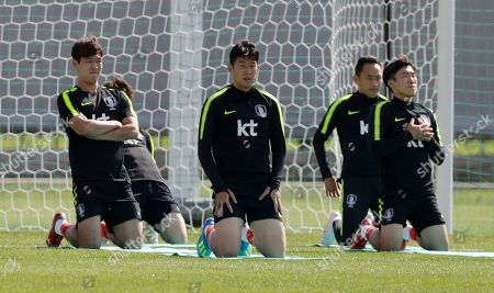 Son Heung-min, Kim Young-gwon, Moon Seon-min, Go Yo-han. South Korea's Son Heung-min, center, Kim Young-gwon, left, Moon Seon-min, second from right, and Go Yo-han, right, stretch during a training session of South Korea at the 2018 soccer World Cup at the Spartak Stadium in Lomonosov near St. Petersburg, Russia