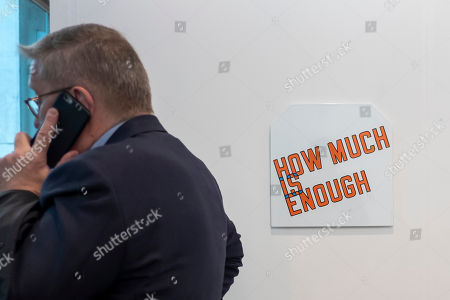 """Stock Image of The artwork """"How Much is Enough"""" (2017) by American artist Lawrence Weiner is on display at the international art show Art Basel, in Basel, Switzerland, 13 June 2018."""