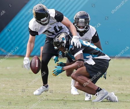 Stock Picture of Charlie Miller, Keelan Cole. Jacksonville Jaguars free safety Charlie Miller, left, breaks up a pass intended for wide receiver Keelan Cole, lower right, during an NFL football practice, in Jacksonville, Fla
