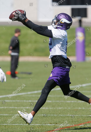 Minnesota Vikings wide receiver Tavarres King catches a pass during practice at the NFL football team's training camp in Eagan, Minn