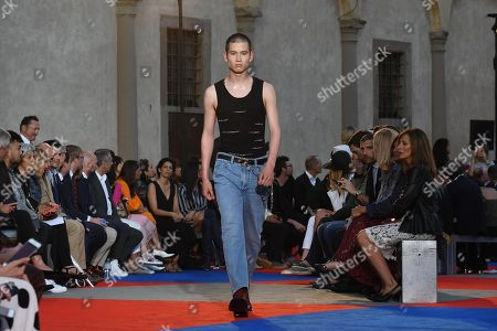 A model presents a creation of Roberto Cavalli first men's collection designed by Paul Surridge during the 94th 'Pitti Immagine Uomo' in Florence, Italy, 13 June 2018.