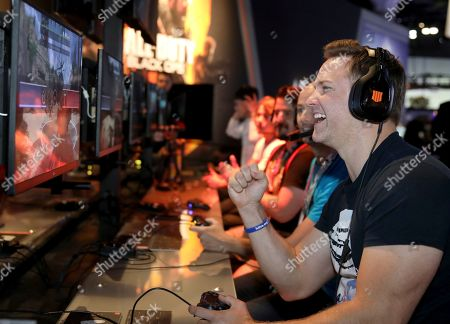 "Actor Scott Porter gets in on the action of ""Call of Duty: Black Ops 4"" at the Activision booth during E3 at the Los Angeles Convention Center on in Los Angeles"