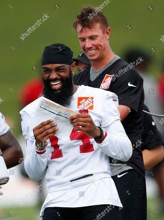 Justin Hardy, Mat Ryan. Atlanta Falcons wide receiver Justin Hardy (14) and quarterback Matt Ryan laugh during NFL football minicamp in Flowery Branch, Ga