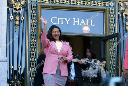 Stock Image of London Breed waves before speaking to reporters outside of City Hall in San Francisco, . Breed was poised to become the first African-American woman to lead San Francisco following a hard-fought campaign when former state senator Mark Leno conceded and congratulated her Wednesday, more than a week after the election