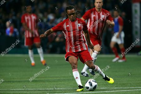 Stock Image of Edgar Davids of Netherland runs with the ball during a charity soccer match between members of the 1998 World Cup winning French team and a team of international veteran players who were also involved in the same tournament, at the U Arena in Nanterre, north of Paris, France