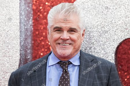 Director Gary Ross poses for photographers upon arrival at the premiere of the film 'Ocean's 8' in central London