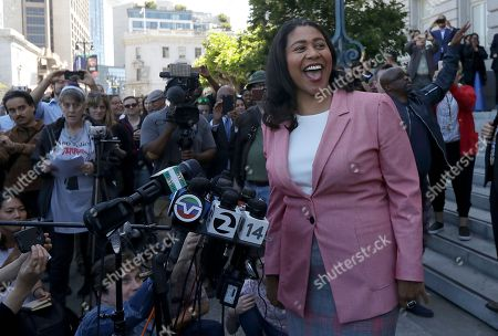 London Breed smiles toward supporters before speaking to reporters outside of City Hall in San Francisco, . Breed was poised to become the first African-American woman to lead San Francisco following a hard-fought campaign when former state senator Mark Leno conceded and congratulated her Wednesday, more than a week after the election