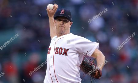 Boston Red Sox starting pitcher Steven Wright delivers during the first inning of a baseball game at Fenway Park in Boston