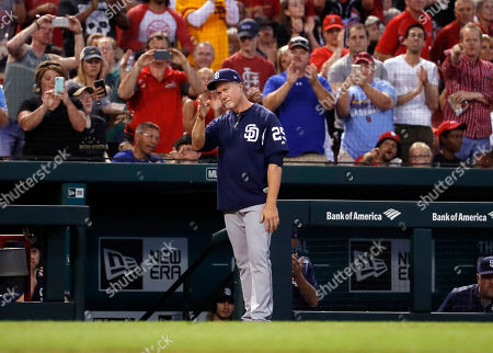 San Diego Padres bench coach Mark McGwire is honored by St. Louis Cardinals fan before the start of the fifth inning of a baseball game between the St. Louis Cardinals and the San Diego Padres, in St. Louis