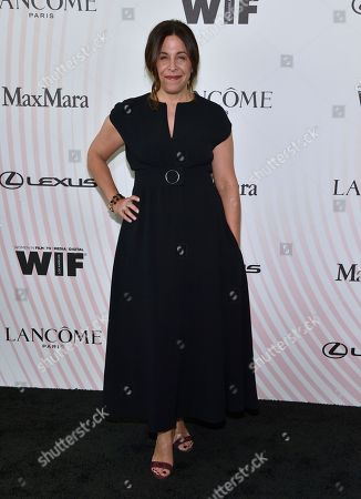 Amy Baer arrives at the Women In Film Crystal and Lucy Awards at the Beverly Hilton Hotel, in Beverly Hills, Calif