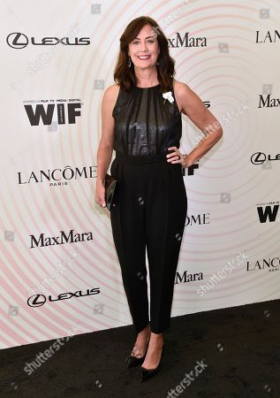 Stock Image of Jane Fleming arrives at the Women In Film Crystal and Lucy Awards at the Beverly Hilton Hotel, in Beverly Hills, Calif