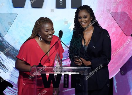 """Stock Photo of Denisea Andrews, Brittany Coney. Denisea """"Blu June"""" Andrews, left, and Brittany Chi Coney accept the artistic excellence award at the Women In Film Crystal and Lucy Awards at the Beverly Hilton Hotel, in Beverly Hills, Calif"""