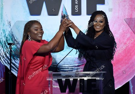 """Stock Picture of Denisea Andrews, Brittany Coney. Denisea """"Blu June"""" Andrews, left, and Brittany Chi Coney accept the artistic excellence award at the Women In Film Crystal and Lucy Awards at the Beverly Hilton Hotel, in Beverly Hills, Calif"""