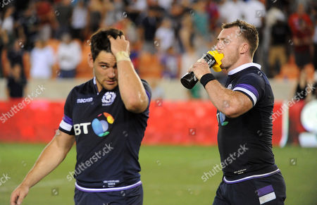 (L) Sam Hidalgo?Clyne and Stuart Hogg - Scotland captain walk off dejected at the end of the match after suffering a 30-29 defeat to the US Eagles.