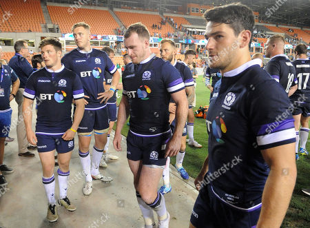 (L to R) George Horne, Lewis Carmichael, Stuart Hogg - Scotland captain, ByronMcGuigan and Sam Hidalgo-Clyne head for the tunnel dejected at the end of the match after suffering a 30-29 defeat to the US Eagles.