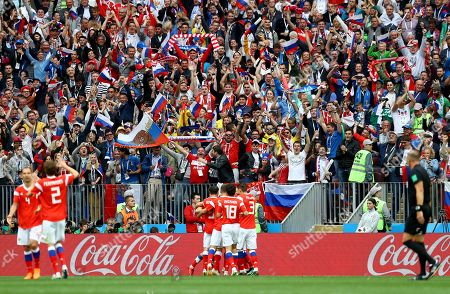 Yuriy Gazinskiy of Russia celebrates the opening goal 1-0 as the fans celebrate