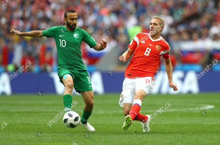 Goalscorer Yuriy Gazinskiy of Russia and Mohammed Al-Sahlawi of Saudi Arabia