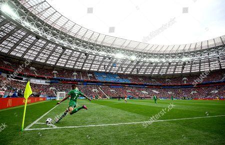 Salman Al-Faraj of Saudi Arabia takes a corner in the Luzhniki Stadium