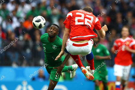 Stock Picture of Artem Dzyuba of Russia scores the third goal 3-0 with a well placed header as Mansoor Al-Harbi of Saudi Arabia looks on