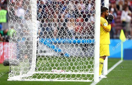 Stock Image of Goalkeeper Abdullah Al-Mayouf of Saudi Arabia looks dejected and prays after the 5th Russian goal