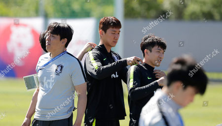 Go Yo-han, Jung Woo-young. South Korea's Jung Woo-young, center, and Go Yo-han prepare for a training session of South Korea at the 2018 soccer World Cup at the Spartak Stadium in Lomonosov near St. Petersburg, Russia
