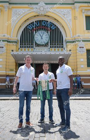 Former footballers Louis Saha, Dennis Wise and Steve McManaman pose with the Carabao Cup outside HMC Post Office