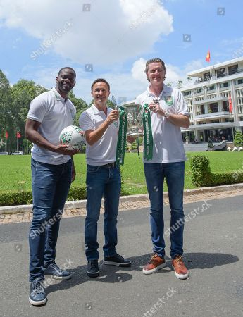 Former footballers Louis Saha, Dennis Wise and Steve McManaman pose with the Carabao Cup outside Independence Palace