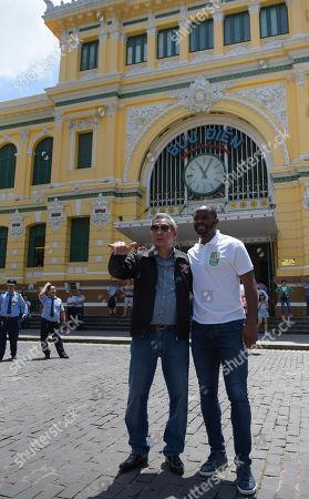 Former footballer Louis Saha poses with representative Mr Phinij Jarusombat for Carabao outside HMC Post Office