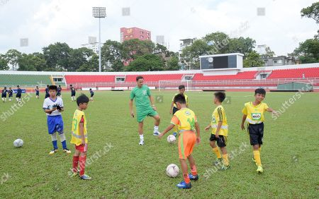 Former footballers Louis Saha, Dennis Wise and Steve McManaman take part in a training session at the Thong Nat Stadium with local youngsters
