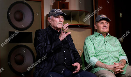 On, Beach Boys musicians Mike Love, left, and Bruce Johnston, right, during an interview with Associated Press at Spiritland in London. The Beach Boys have a new CD with the Royal Philharmonic Orchestra that gives a classical twist to their sunny 1960s hits. Classics like 'Good Vibrations' and 'Wouldn't It Be Nice' mix the band's vocals with orchestral backing in an approach that's worked earlier for tunes by Elvis Presley, Roy Orbison and Aretha Franklin