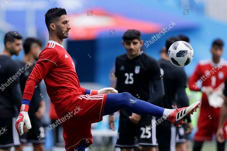 Iran goalkeeper Amir Abedzadeh controls the ball during the official training of Iran on the eve of the group B match between Morocco and Iran at the 2018 soccer World Cup in the St. Petersburg Stadium in St. Petersburg, Russia