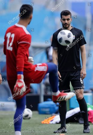 Stock Picture of Iran goalkeeper Amir Abedzadeh, left, and Iran's Saeid Ezatolahi practice during the official training of Iran on the eve of the group B match between Morocco and Iran at the 2018 soccer World Cup in the St. Petersburg Stadium in St. Petersburg, Russia