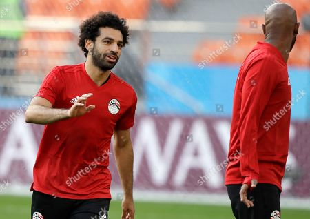 Mohamed Salah, Shikabala. Egypt's Mohamed Salah, left, and teammate Shikabala talks during Egypt's official training on the eve of the group A match between Egypt and Uruguay at the 2018 soccer World Cup in the Yekaterinburg Arena, Yekaterinburg, Russia