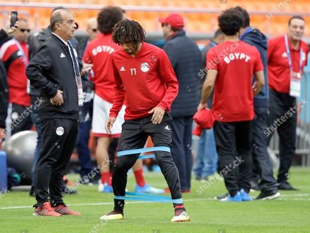 Egypt's Kahraba stretches during Egypt's official training on the eve of the group A match between Egypt and Uruguay at the 2018 soccer World Cup in the Yekaterinburg Arena, Yekaterinburg, Russia