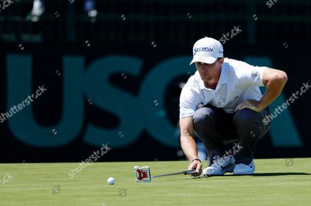 Cole Miller lines up his putt on the seventh green during the first round of the U.S. Open Golf Championship, in Southampton, N.Y