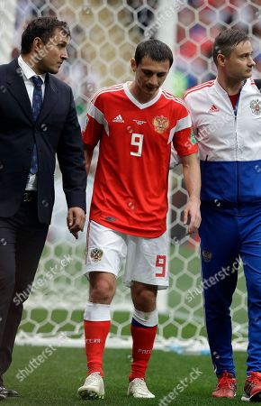 Russia's Alan Dzagoev leaves the pitch injured during the group A match between Russia and Saudi Arabia which opens the 2018 soccer World Cup at the Luzhniki stadium in Moscow, Russia